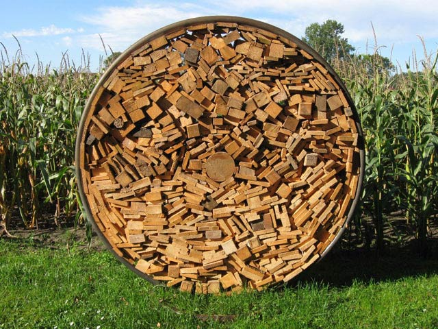 Holzdepot aus Stahlringen – rund ist warm